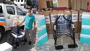 7 bedensel engelli sığınmacıya tekerlekli sandalye yardımı